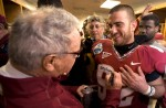 Bowden autographs his player's jersey's in the locker room after winning the Gator Bowl