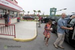 Sasha Obama heads to the car while Barack and Michelle eat there ice cream in Panama City Beach, FL.